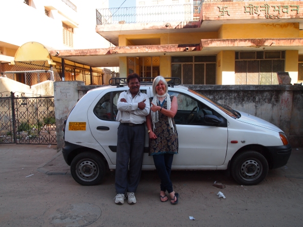 Singh and me and his little car, in which we've spent the last 7 days....