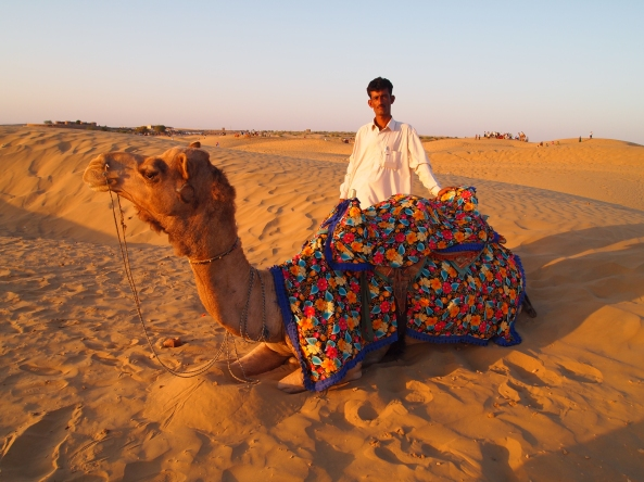 our guide and our camel ~ taking a rest
