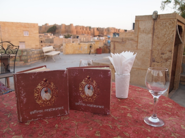 Saffron menus with Jaisalmer Fort behind