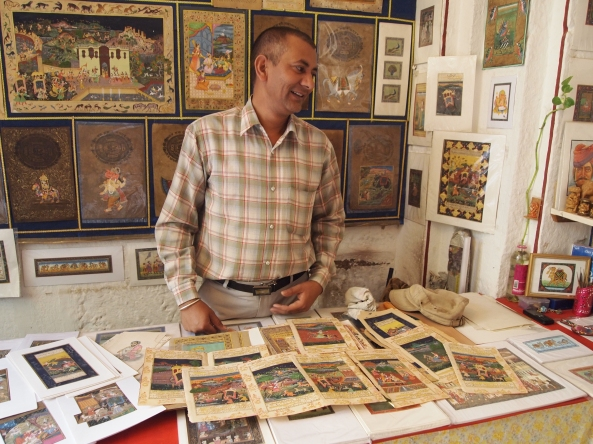 A shopkeeper selling Indian prints at the hotel
