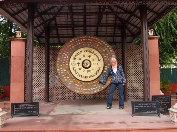 pointing to the U.S. flag on the World Peace gong