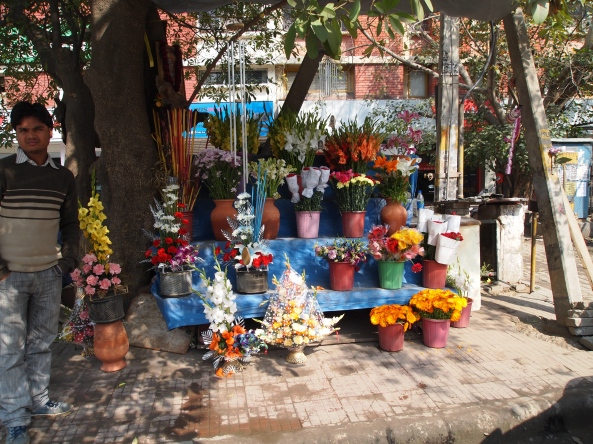 selling flowers outside of Nirula's