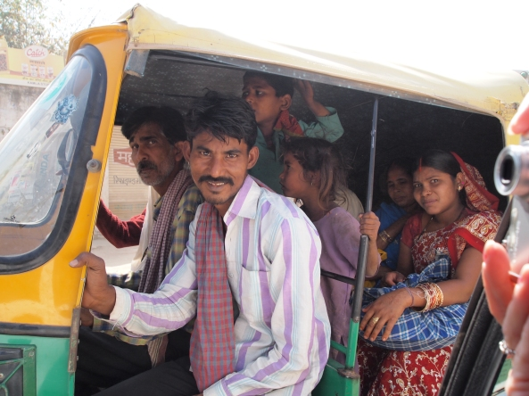 whole families pack into auto-rickshaws