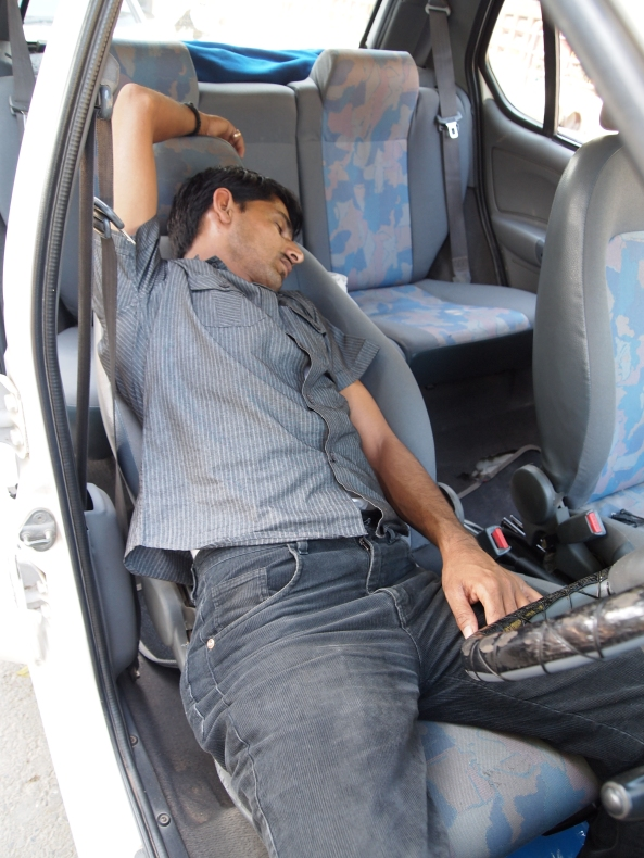 our surly driver Sanjay in Varanasi, napping