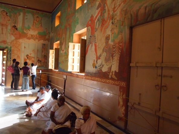 beautiful murals of the buddha's life in the buddhist temple