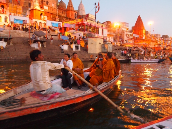 boats with orange-robed monks