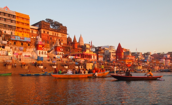 the sun rises over the ghats