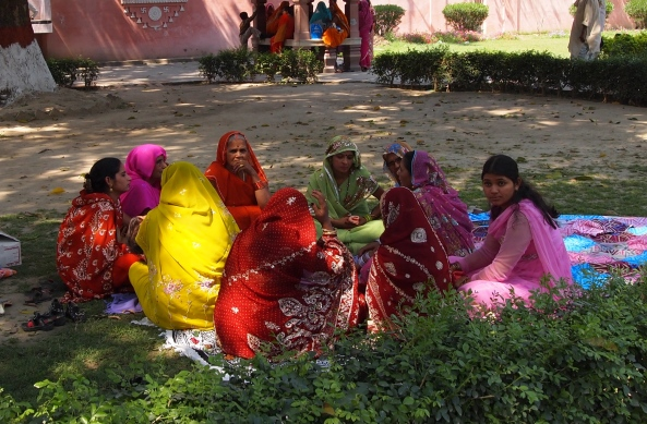 colorfully-dressed women have a picnic