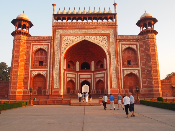 the red sandstone south gate to the Taj Mahal, inscribed with verses from the Quran