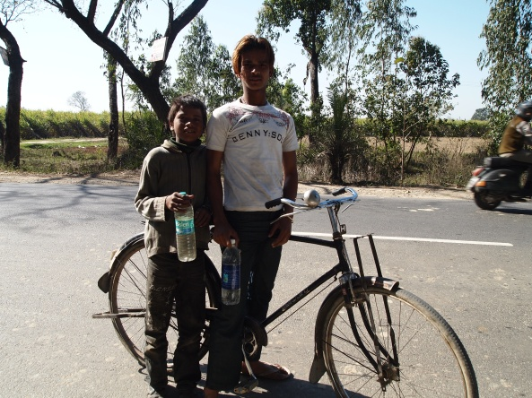 these two boys help us by riding ahead and filling up water bottles for our radiator...