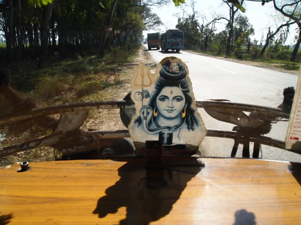a goddess watches over us in the auto-rickshaw