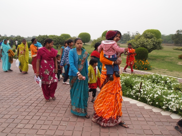Indian ladies at the Lotus Temple in colorful saris and salwar kameez