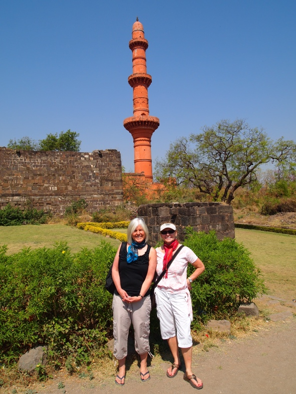 two weary travelers hiking up to the top of the hilltop fortress of Daulatabad