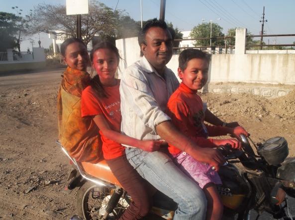 a family celebrating Holi