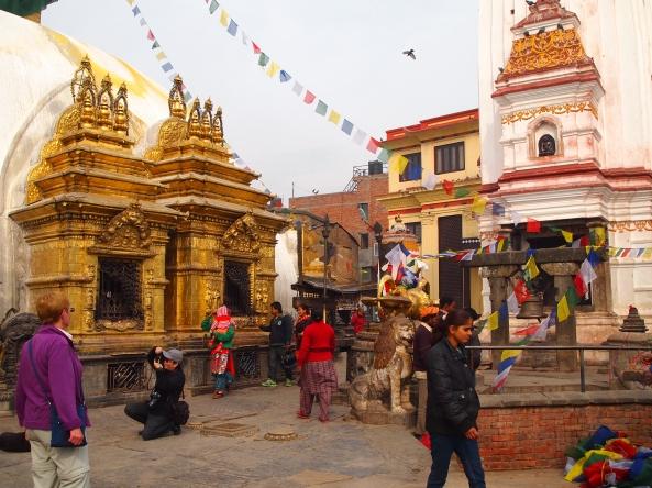 pilgrims and tourists rove around the stupa