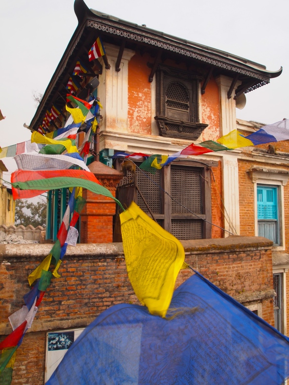 colorful prayer flags representing the 5 elements of earth, water, air, fire & sky