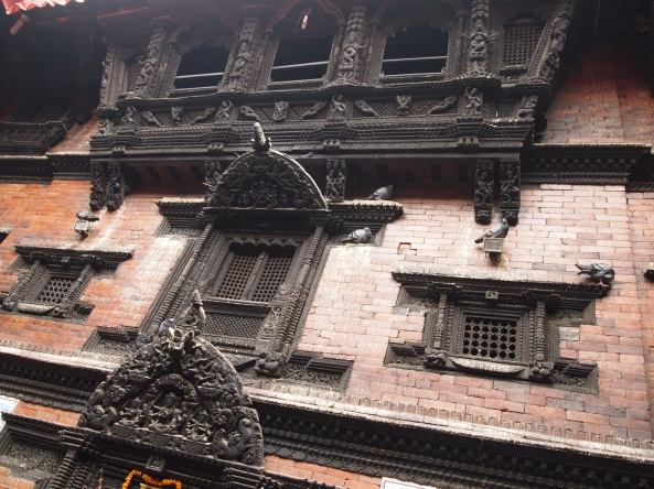 the exquisitely carved windows and doors of Kumari Chowk