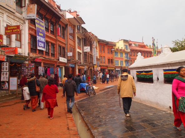 pilgrims & tourists walk clockwise around the Boudha stupa