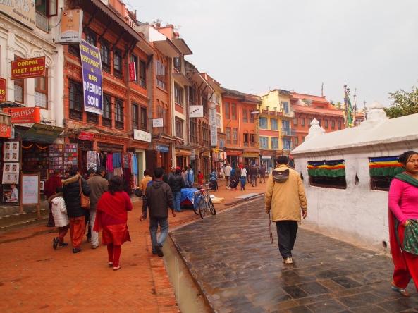 pilgrims & tourists walk clockwise around the Boudha stupa