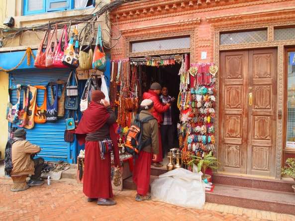 shops around the perimeter, with a line of pilgrims or monks
