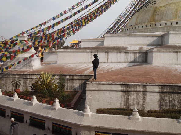 a solitary figure on the Boudha contemplating... life?
