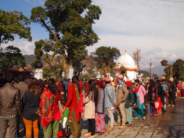 lines of pilgrims waiting to present offerings to the goddess