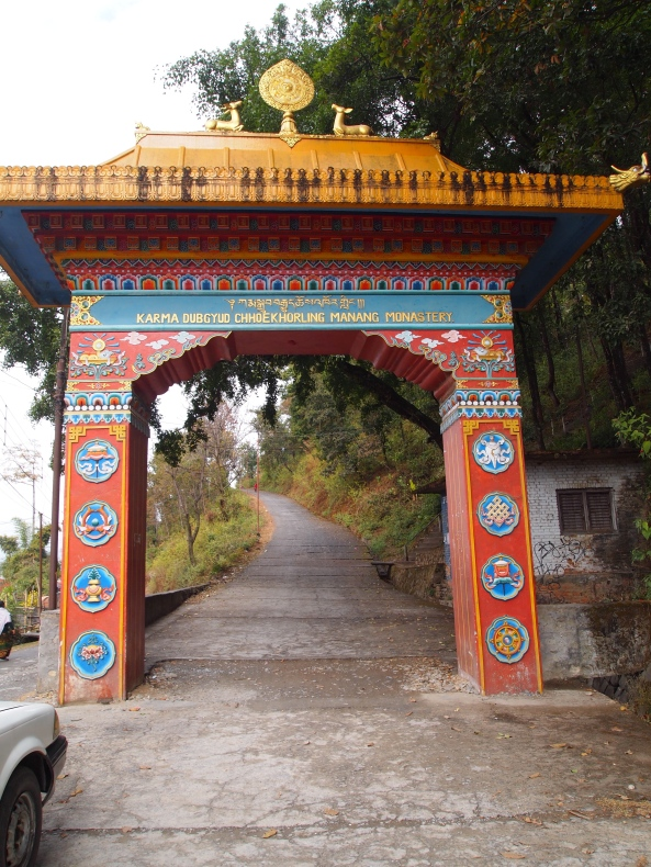 the arch leading to the stairway to the Buddhist Monastery