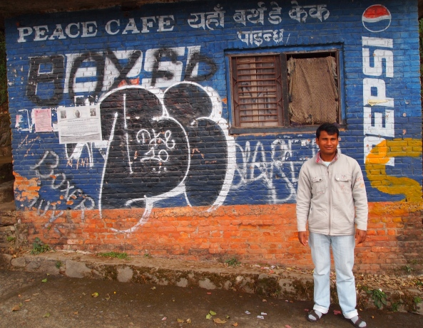 my driver and the now dilapidated Peace Cafe