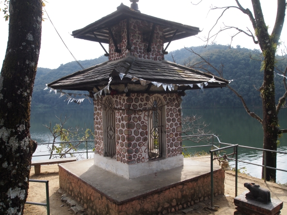 a little shrine or temple on the lake
