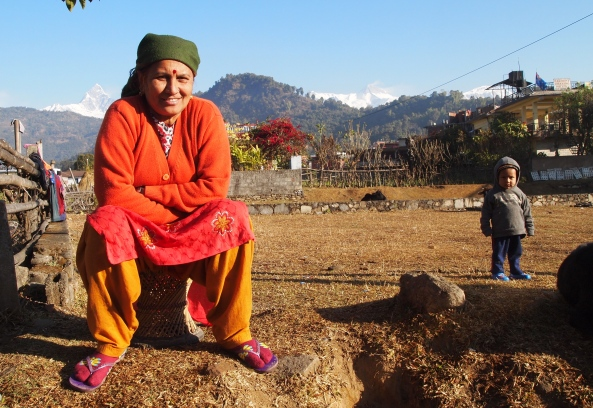 Nepali woman sitting along the roadside