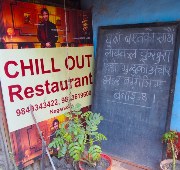 Chill Out Restaurant and Nepali writing on the blackboard