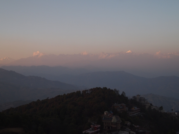 the sun sets over the Langtang Range