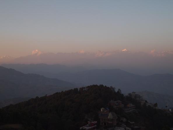 the sun sets over the Langtang Range