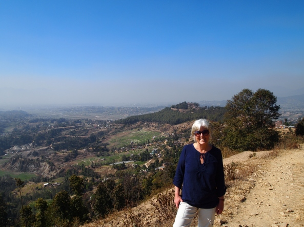 me with my destination, Changu Narayan, on the hilltop behind