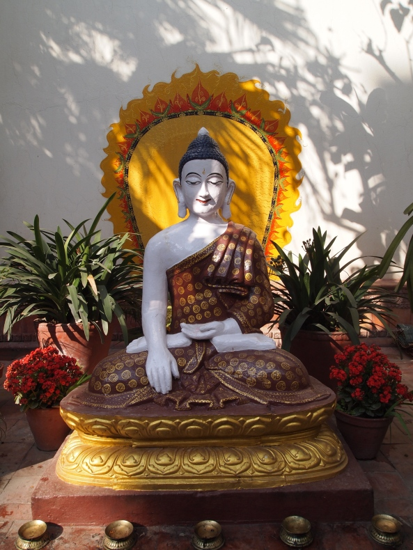 the meditative Buddha in the courtyard of Kathmandu Guest House