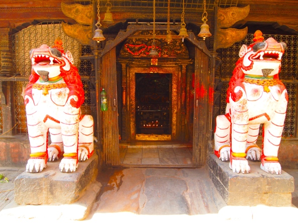 a temple with guard dogs