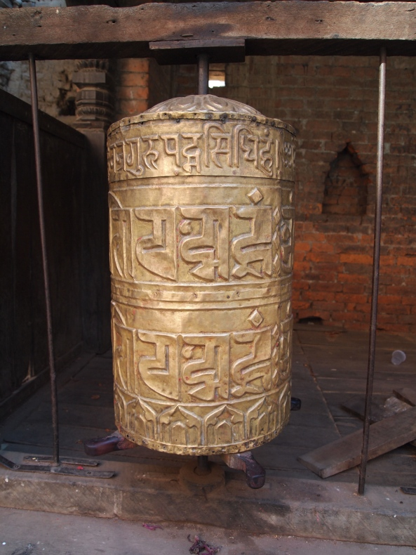 a prayer wheel in the temple