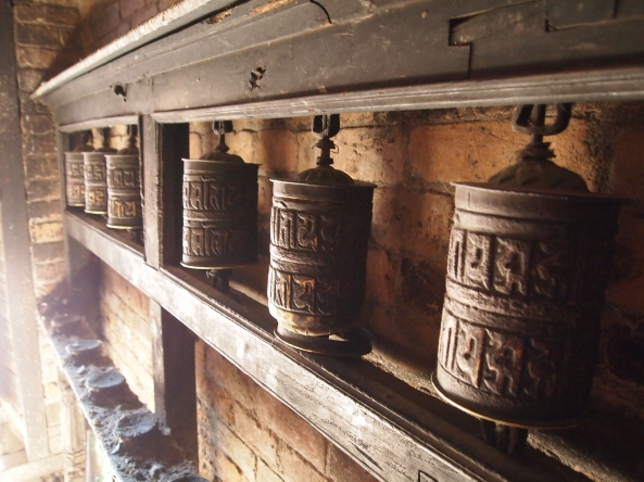 other prayer wheels in the exit corridor