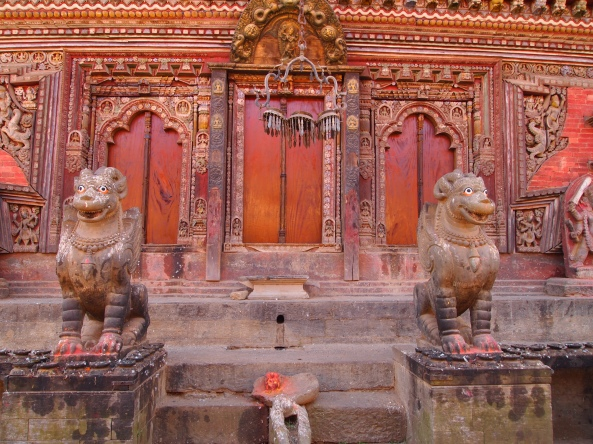 griffins guard the entrances to the temple